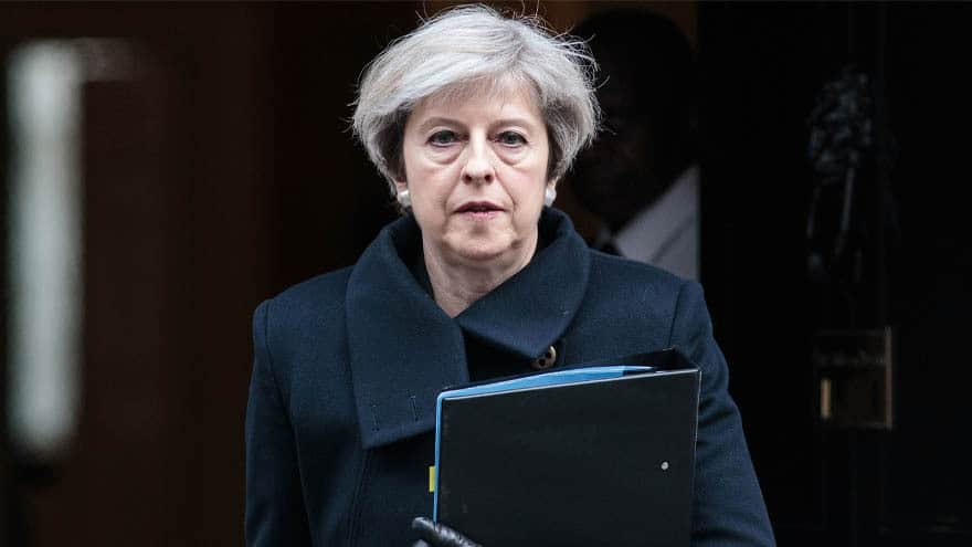 Partner Content - MAY'S DAY: British Prime Minister Clings to Power after Disastrous Brexit Vote