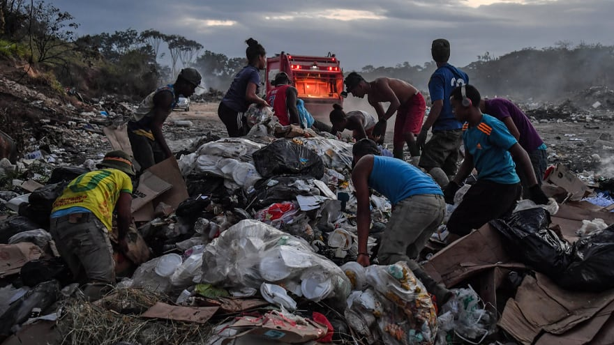 Partner Content - PARADISE LOST: Starving Venezuelans Compete with Vultures, Animals for Brazil's Excess Garbage